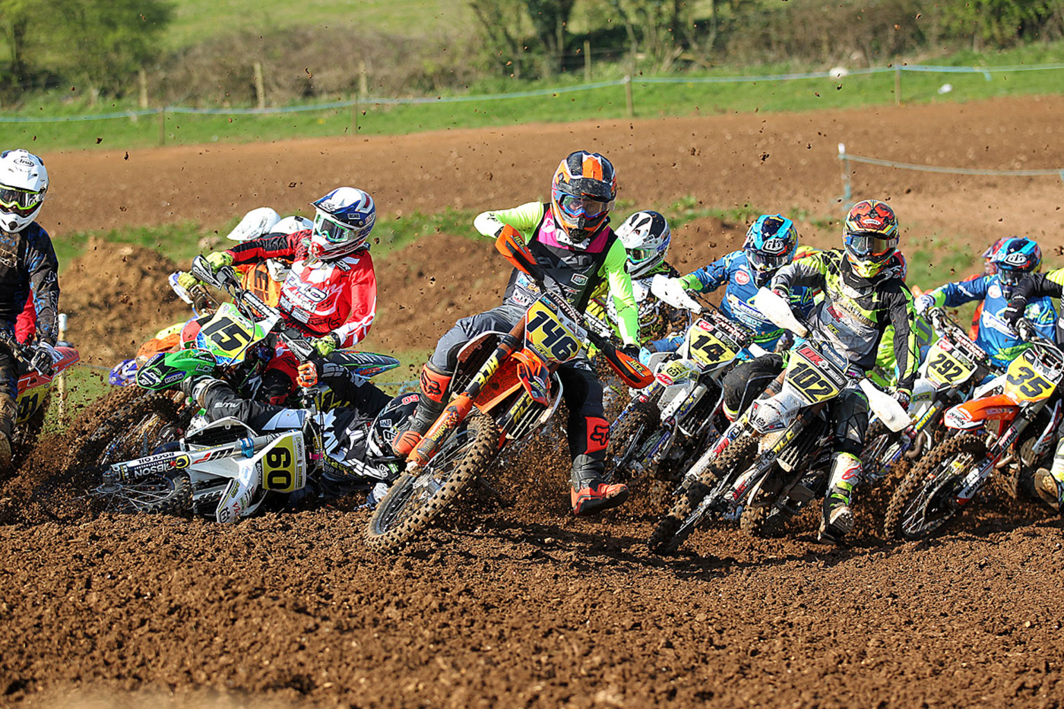 Ryan-Crowder146-grabs-the-first-MX1-holeshot-of-2017-as-Arran-Poolman60-crashes
