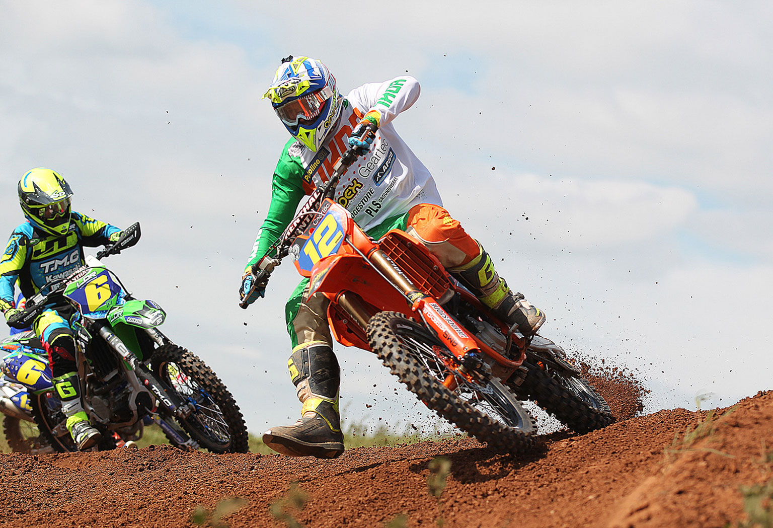Ray Rowson(12) leading Jansen Day in MX2 moto two