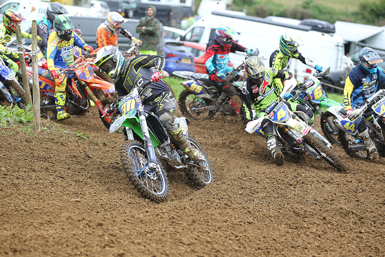 Lewis King(311) grabs the MX2 holeshot followed by Bradley Tranter(4)