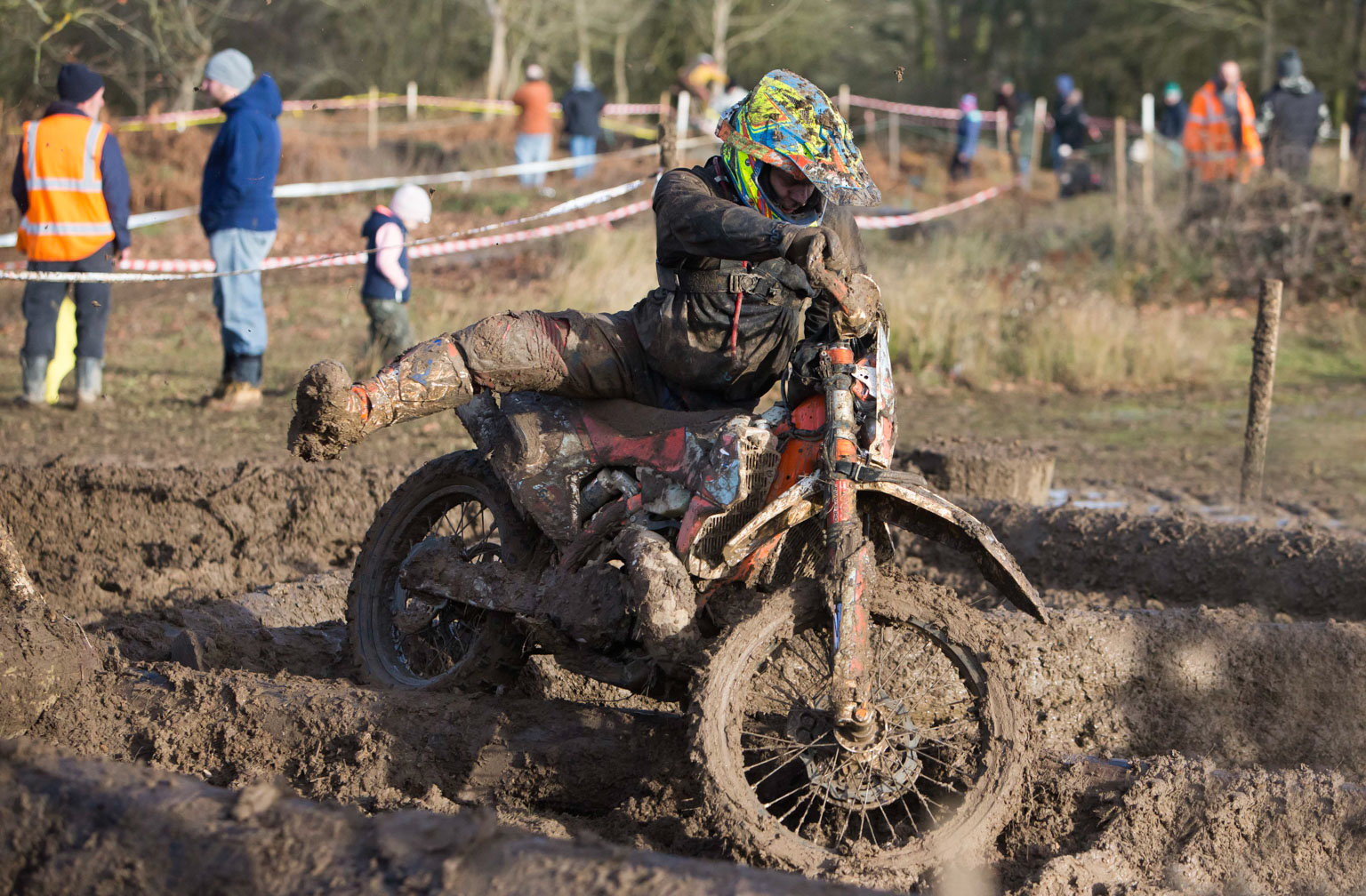 Stephen Lander struggles in the mud