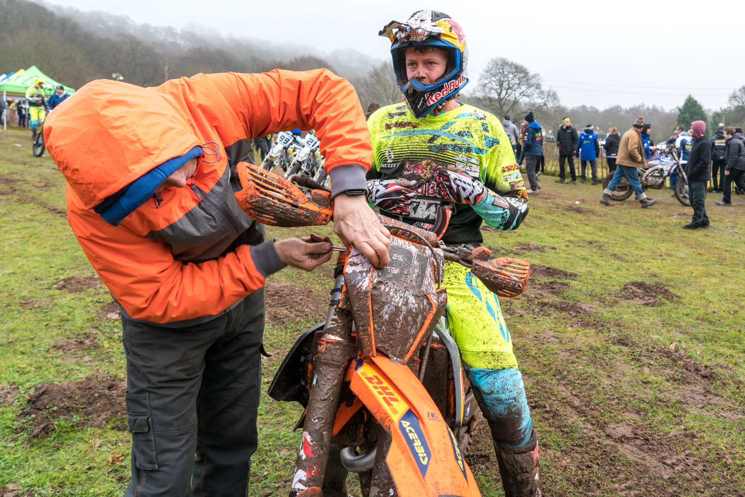 Watson gets his headlight cleaned by dad Rob Meek at Hawkstone last year