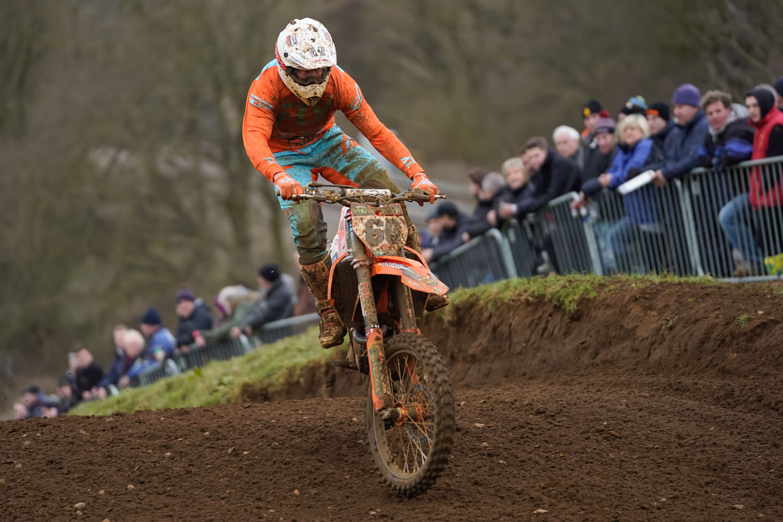 Brad Anderson in typical Ando style. Flat out, feet off the pegs, bike sidways and no fear. He was fourth overall in MX1