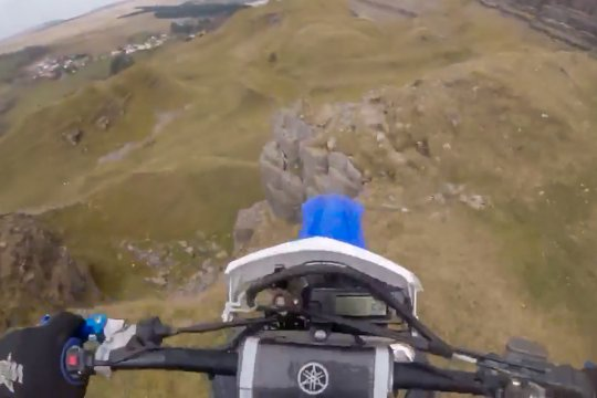 Adrian Owen rides off cliff